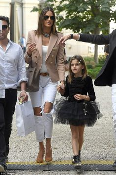 Like mother like daughter:Alessandra was later seen leaving the show with her adorable daughter, 7-year-old Anja Mazur - June 2016