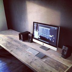 Minimalist desk. Wood contrast against dark wall/light wall