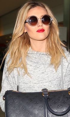 Perrie Edwards, Little Mix girls seen arriving back at Heathrow from Tokyo, 28 January 2014