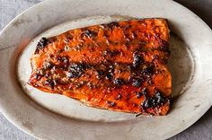 I think this may be my favorite salmon recipe, and I've tried a lot over the years. The ginger and sweet glaze is such a perfect complement to the salmon, and it's surprisingly easy. Roasting it at a low temperature keeps the fat from rendering out of the fish, so the fish stays moist and succulent. Leftover glaze can be used on anything, scallops, pork, you name it. Red wine is not really Asian, but it really does work well and gives more depth of flavor than sake would.