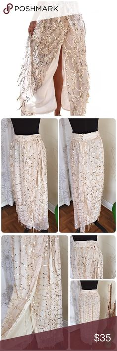 Split Sequin Long Skirt NWOT Sexy side split sequined long skirt. No tag, direct from manufacture. Side zipper with tie for bow. Fully lined. Fit best for size 0-2.  Refer to measurement ❤️Waist 27 ❤️ Length 38.5❤️ Polyester/Mesh❤️ boutique Skirts Maxi