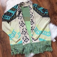 Colorful fringe cardigan sweater Perfect adorable sweater thats comfortable and gorgeous! Aruna Intarsia Sweater Drape Cardigan. Gupsy 05 brand from anthro. Offers welcome through offer tab. No trades. 112015390 Anthropologie Sweaters Cardigans