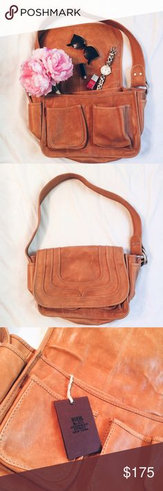 """✨HP!✨ NWT Ruehl No. 925 Leather Satchel New with tags, never used. 100% softened leather. A classic staple piece! Rich brown satchel with large back pocket, two front pockets, two side pockets, two inside pockets, and an inside zipper pocket. Silver hardware. Length: 17 inches. Height of body: 12 inches. Width: up to 6,5 inches. From top of strap to bottom of bag: 25 inches. From tag: """"unique artisan details, leather embossing, distressed washed make for a vintage appearance"""" Ruehl No. 925…"""