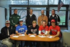 YHS players sign D1 letters of intent. (Coaches also in pic - not named)