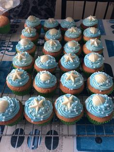 Ocean cupcakes with white chocolate shells and starfish. Pearls and glitter too for added wow factor! Merryn's Under The Sea / Ariel /Mermaid party