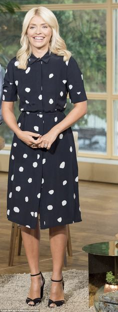 Sensational: The blonde cut a noticeably slimmer figure on the screen on Tuesday when she appeared in a black polka dot dress and heels to match