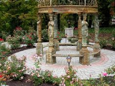 This tranquil rose garden is enhanced by a circular sculpture display created from Old Towne Cobble pavers.  www.ephenry.com