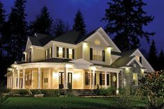Spacious, modern Farmhouse style home with large wraparound porch.  Farmhouse Home Plan # 551196.