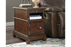 The Lavidor chairside end table serves up a traditional sense of style with fresh, relevant flair. Richly grained with so much tonal depth, Lavidor's wood veneers are treated to a smooth-to-the-touch, high-sheen finish. Elements including a pull-out tray and cabinet storage bring handy function to great form.