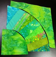 Another project(5/29/15) I'm working on NYB using scraps for center piece and one 10 inch batik  layer cake for center point and outside edge, all blue greens and greens. Love it so far. Jenn-Alabama