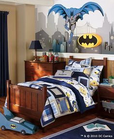 I always think if you want to go for a themed kids room, go big or go home... like this batman room! Love the bat signal light and the mural.