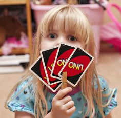 3 Ways to help little hands hold playing cards - I like the Clothespin best - because I'm most likely to have one handy! #kids #games #cards