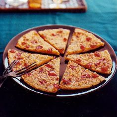 Chickpea Flour Pizza with Tomato and Parmesan INGREDIENTS 2/3 cup chickpea flour (see Notes) 1/3 teaspoon salt 1 cup water 1/2 teaspoon finely chopped rosemary 3 tablespoons extra-virgin olive oil 2 tablespoons chopped tomato 1 tablespoon finely chopped onion 3 tablespoons freshly grated Parmesan cheese 1/4 teaspoon freshly ground pepper