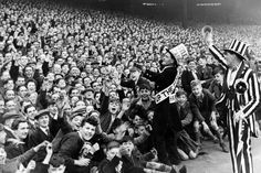 Newcastle mascot Jimmy Nichol leads the cheers of the Newcastle crowd at the Leazes End before a game with Sheffield Wednesday on April 1949 Newcastle United Wallpaper, Sheffield Wednesday, Newcastle United Football, Newcastle England, Sir Alex Ferguson, St James' Park, Football Stadiums, Boys Playing, Manchester United
