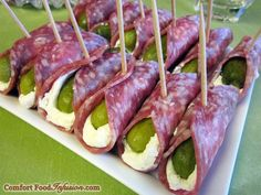 Pickles in a blanket, or pickles wrapped in salami. Mini dill pickles wrapped with cream cheese and salami make a super quick, easy and tasty hors d'oeuvre.
