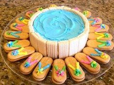 Round Flip Flop Pool Cake with Deck Chairs - All About Flip Flops Perfect food for a luau Hawaiian party Hawaiian Party Foods, Luau Party Foods, Luau Party Cakes, Hawaiian Cakes, Tropical Party Foods, Luau Birthday Cakes, Luau Theme Party, Hawaiian Luau Party, Party Food Themes