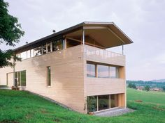 Larch shadow reveal facade incorporates railing for upper covered deck | Dietrich Untertrifaller Architects | Austria