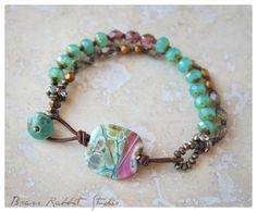 """A rustic Boho style Stacker with handmade artisan lampwork glass focal (BeadedGift), aged Czech glass, and a leather and aged turquoise crystal button closure. Fits a 6.25""""-7"""" wrist, leave a note if you need the size adjusted."""