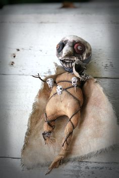 Plague Dr OOAK voodoo doll from the dark ages, made with polymer clay and unbleached muslin.  Skull pins are made of paper clay and one of a kinds