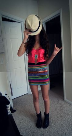 hot pink shirt and tribal skirt.