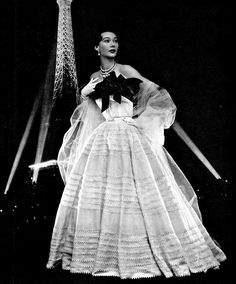 1951 Sophie Malgat in white organdy gown adorned with red roses by Jacques Fath