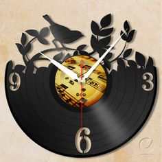 vinyl wall clock  garden bird by Anantalo on Etsy, ฿1,100.00