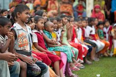 "Kids in Shariatpur, Bangladesh, watch a community drama called ""Pot Song."" Our local partners use drama and music to teach communities about hygiene and sanitation. Songs and plays reach illiterate adults here and also keep the kids engaged."
