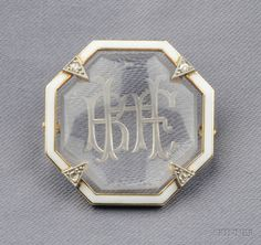 """Rock Crystal, Enamel and Diamond Brooch, Cartier, 1932, centering a buff-top crystal tablet reverse carved with the initials """"BFH"""", white enamel and single-cut diamond accents, platinum and 14kt gold mount, lg. 1 in., signed CARTIER."""