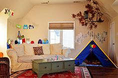 """kids playroom with """"stations;"""" dress-up corner, camp-out corner (real tree branch hung from ceiling)"""