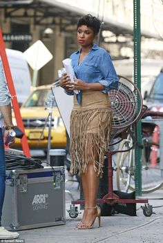 Standing tall:The singer also sported a leather skirt with long tasseled fringes as she wore open toe stilettos