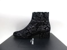 f1c93ea1f48fc Beautiful boots by Saint Laurent. These are made of black suede leather  with silver animal print spots all over. There are inside zippers for  closure.