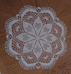 "This is a brand new hand crochet doily in the Hearty Flower design. The color is Ecru. It is 23"" round. This is an original made by Grammie, it is not a resale Doily. Made in a Smoke and Pet free home. 