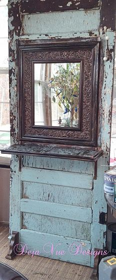 Old door made to stand with added mirror, hooks & shelf...love!