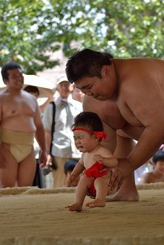 Baby sumo festival, Japan | I'd be scared too, little dude.  U could get lost in his butt cheeks | December 21