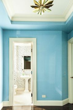 Learn how to balance vibrant color for style impact. This eclectic aqua blue is an ideal color to brighten up your hallway. Click for even more pieces of unique design inspiration.