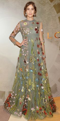 """All eyes were on Alexa Chung at the opening night of """"BVLGARI & ROME: Eternal Inspiration"""" in New York City. Chung wowed in an enchanted, floral-embroidered tulle gown by Valentino. To take the romantic look one step further, Chung accessorized with a crystal hair pin and chandelier earrings."""