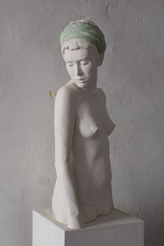 sculpture of girl with butterfly, by Jeanne Isabelle Corniere, resin