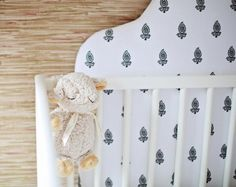 A Glam Gold and Grasscloth Nursery