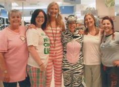 STAFF at an Ashbourne store donned onesies and pyjamas as part of a nation-wide fund-raising effort.