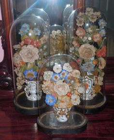 Victorian Glass Parlor Domes filled with flowers made from paper...wax...silk...shells...real dried flowers....love