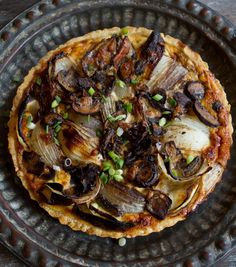 This is the time of year when I start craving savory tarts. This vegetarian tart has vinegar-roasted onions, mushrooms, and ricotta cheese, making it a great appetizer for a group, or a dinner for two when served with a side salad. Why not? It's getting cold out there and sometimes you just need a dinner that feels like the food equivalent of sliding on a cashmere sweater: decadent and yet perfectly functional.