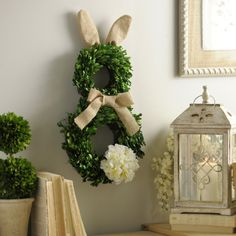 Celebrate the spring season and Easter with the Boxwood Easter Bunny Wreath. The green leaves, burlap accessories and cute bunny shape.