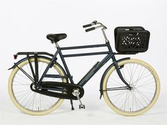 The Flying Gentleman in matte blue, with a mini front rack and hand-luggage box