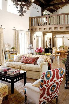 Liven things up by covering the sofa with a throw, adding some large graphic pillows & covering the back of a neutral chair with a bold print