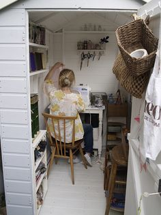 I would be more than happy with my very own teeny sewing space like this!