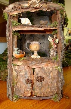 Faerie Hutch from The Faerie Tailors Furniture Catalogue love the little alder cone cabinet door knobs! -- http://realresultsin3weeks/