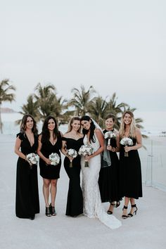 Stunning bride and her bridesmaids wearing all black and whites Mens Beach Wedding Attire, Beach Wedding Bridesmaids, Beach Bridesmaid Dresses, Beach Wedding Colors, Black Bridesmaids, Boho Wedding Dress, Black And White Beach, Mexico, Center Pieces