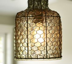 2 of these over the dining table.  from pottery barn... could I diy? I'm thinking a mason jar and ORB spray painted chicken wire???