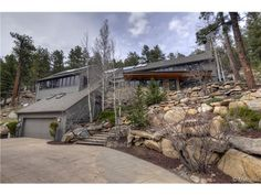 View listing details, photos and virtual tour of the Home for Sale at 31899 Quarter Horse Road, Evergreen, CO at HomesAndLand.com.