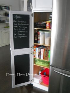 The inside of the pantry door is a perfect place for chalkboard paint. Write your menu on top and let the kids draw on the bottom. (Homey Home Design)
